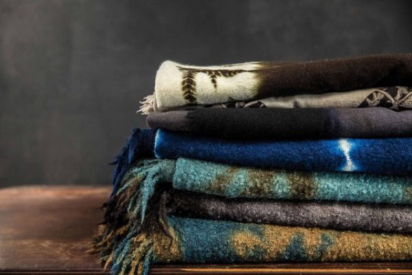 """A stack of scarves from the label """"Suzusan"""""""